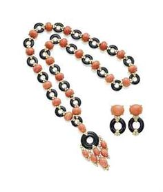 A CORAL, ONYX AND DIAMOND NECKLACE, BY VAN CLEEF & ARPELS, AND A PAIR OF MATCHING EARRINGS Comprising a sautoir designed as a series of oval cabochon coral between circular-cut diamond trefoil shoulders, with onyx circlet spacers, to the detachable similarly-set pendant, a pair of earrings en suite. Pendant and necklace signed Van Cleef & Arpels, nos. 24099 (pendant)
