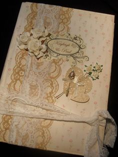 Custom made photo album for the Bride & Groom in shabby chic, vintage scrapbook style, vintage lace and gold coloured cameo pin attached, which can be removed and worn by the Bride if she wishes.  Handmade by myself Anna at Rose Anna Keepsakes on Etsy.com