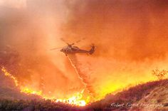 An L.A. County Firehawk makes a night drop on a fire in Bell Canyon, CA.