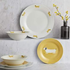 Designed with an adorable sausage dog detailing, this dinner set has been finished in a vibrant ochre yellow colourway and crafted from durable porcelain. Side Plates, Small Plates, Decorative Plates, Dinner Set Design, New Home Wishes, Uni Room, Dinner Sets, Dinnerware Sets, Dinner Plates