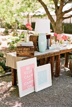 Brides.com: A Pink-Themed Outdoor Wedding. Guests were encouraged to peruse the couple's book collection on the welcome display.