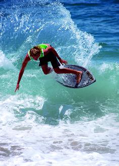 Surfing at Brooks Street Beach in Laguna Beach, CA
