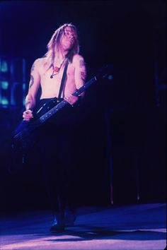 gunsnrosesfanscom:  Axl playing bass? Find more of these rare pics at the photo albums of our Facebook Page => Guns N' Roses Fans Axl with bass ;o