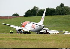 This TNT Boeing 737-301(SF) lost part of its undercarriage during an attempted landing in poor visibility.