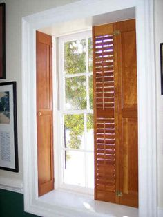 Like the natural wood shutters. These particular shutters are called pocket shutters.