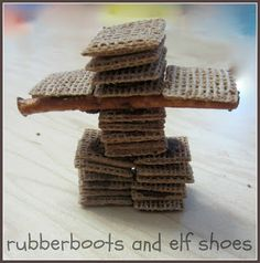 Edible Inukshuk - a symbol of Canada. Uses shreddies, pretzel stick, and chocolate icing. Sensory Activities, Kindergarten Activities, Activities For Kids, Art For Kids, Crafts For Kids, Aboriginal Education, Ontario Curriculum, Ab Day, Elf Shoes