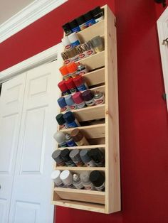 Spray can holder hung with french cleats. Would a miniature version work for our large collection of acrylic paint? #WoodworkingTips