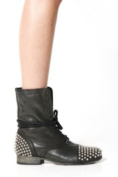 Totally rad combat boots feature lace up vamp and studded toe and heel detail. Toughen up a girly party dress or pair with your fave skinnies and a slouchy tee!Leather upper