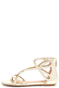 """A little glam can go a long way, and with the Chinese Laundry Penny Gold Gladiator Sandals you'll really go the distance! Shiny metallic faux leather straps cross over a peep toe upper, and meet an adjustable buckle strap at the outstep. 4"""" heel zipper."""