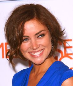 good curly  hair cuts for big chins | Jessica Stroup gives her chin-length bob a retro vibe with lots of ...