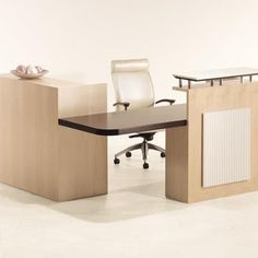 OFS Reception Desk features dual heights, multiple finishes & materials