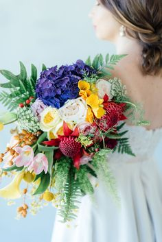 "STUNNING tropical wedding bouquet made from a cascade of bright blue hydrangea, yellow lilies, ferns, tulips. roses, queen annes lace, billies balls, protea and beautiful blooms! Super cute ""tutti frutti"", Carmen Miranda style tropical flower crown for a tropical bride in bright colors. Fun and cute. Tropical Wedding Ideas photographed by Debbie Lourens Photography http://www.confettidaydreams.com/tropical-wedding-ideas/"