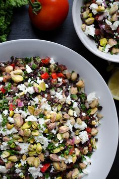 Black Rice Tabbouleh with Chickpeas Feta and Pistachios - black rice adds so much nutty nutrition along with hearty chickpeas and crunchy pistachios! *To keep this vegan, omit the feta cheese or sub with vegan shreds.   @tasteLUVnourish on TasteLoveAndNourish.com