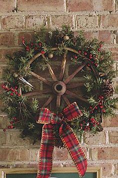 Turn antique wagon wheel into a holiday wreath! Find a wagon wheel! Cowboy Christmas, Rustic Christmas, Christmas Holidays, Christmas Snowman, Christmas Porch, Father Christmas, Outdoor Christmas, Western Christmas Tree, Tartan Christmas