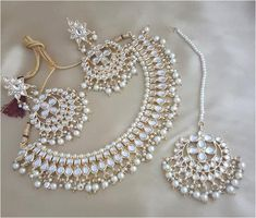 Aashkaanya is an Online Traditional Indian Imitation Jewelry Boutique. The new destination for your shopping hub. Explore all collection for new designs and more colors. Let's Show The World You Shine. Indian Bridal Jewelry Sets, Indian Jewelry Earrings, Jewelry Design Earrings, Jewelery, Choker Jewelry, Gold Necklace, Antique Jewellery Designs, Fancy Jewellery, Gold Jewellery Design