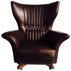 G Plan 6250 Leather Swivel Wing Chair | From a unique collection of antique and modern armchairs at https://www.1stdibs.com/furniture/seating/armchairs/