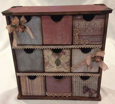 This beautiful mini chest of drawers is ready to store all of your treasures. It is hand made using quality papers and embellishments. The