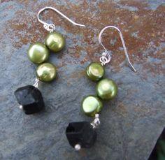 black with green earrings