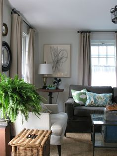 like the greys and neutrals popped with black and white artwork and the amazing blue and green ikat pillows