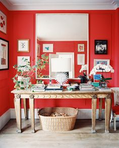 If red is too bold for you, consider pairing with wood furniture and oversized white mirror.