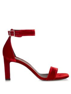 Crafted from opulent ruby-red velvet, Saint Laurent's Grace sandals are destined for late-night dates. They're shaped with two slim front straps and a moderate heel – perfect for slipping straight from desk to dance floor.