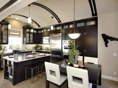 Dramatic Kitchen    An arched ceiling gives an Old World look to this California kitchen.