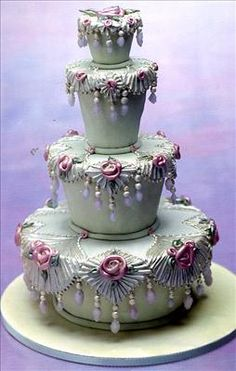 A very ornate cake.  Don't think I could ever have an occasion to want this cake for it.  Maybe it is the color of the cake.  If it were in white, pearly white, and light pink, I might lke it more.