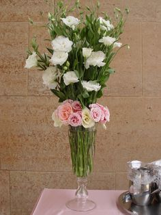 white lisianthus and roses