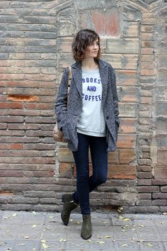 """Jeans, ankle boots, coat and """"coffee and books"""" T-shirt."""
