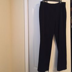 Ladies slacks Large size 8 black unlined slacks. Polyester, viscose, spandex. Worn once. Concealed front closure and zipper. Two back pockets. Machine wash and dry.  Heavy fabric. Wrinkle free. Excellent condition. Brand is Atalier (purchased at stein mart) Pants Trousers