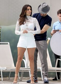 She looks good in white! Eva is seen on a photo shoot on May 9 during Cannes Film Festival