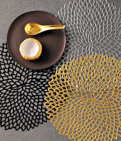 Chilewich - Dahlia  Dahlia vinyl placemats in black, gunmetal, and gold by Chilewich