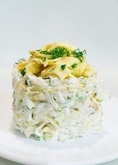 Salad of cabbage with chicken and egg pancakes