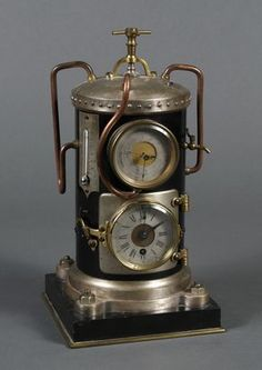"c. 1890 FRENCH VERTICAL STEAM BOILER CLOCK - A rare clock from the Industrial Series. The boiler has pipes and gauges; the 8-day clock platform and the aneroid barometer are set in the side of the round boiler. Unmarked. Condition good; maybe missing the flyball governor; minor finish loss and several scratches as seen; no key; untested. 12""H"