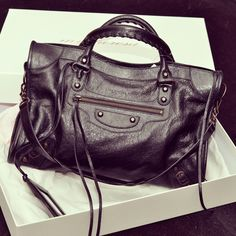 THIS is Whitney's It bag! A Balenciaga Motorcycle bag.