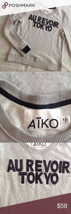 """AIKO Au Revoir Tokyo Blogger Celeb Sweatshirt Excellent used condition. Giacomo Sweatshirt by AIKO, a Neiman Marcus brand. Heather gray with black lettering across the front spelling out """"Au Revoir Tokyo."""" Ribbed cuffs with black patch detail. Banded hem and ribbed neckline. 80% cotton, 20% polyester. A blogger and celebrity favorite. Size XS, see photos for measurements. Aiko Tops Sweatshirts & Hoodies"""