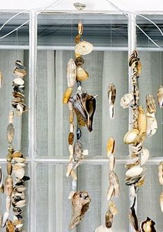 Make a wind chime with a wire hanger and #shells! #shellcrafts #windchimes