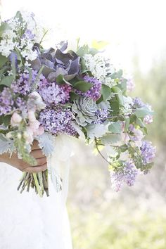 Floral design by Intertwine, Bridal bouquet of lavender and white lilacs, dusty miller, succulents, snapdragons