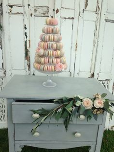 Grey chest of drawers to hire, great for cake table.  Www.littleweddinghelper.co. Uk