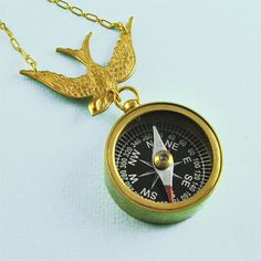 Working compass necklace with gorgeous brass swallow bird. £25  pennymasquerade.com