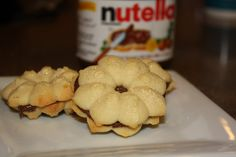 Spritz sandwich cookies with Nutella filling.