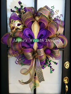 Mardi Gras Wreath with Fleur de Lis, ornaments, picks, deco mesh, and mask Jayne's Wreath Designs