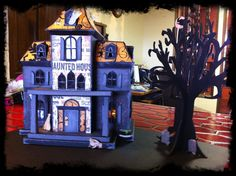 My Haunted House.  Made by using Sizzix eclips, ecal, and cutting file from SVG Cuts.com.