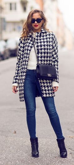 Kenza Zouiten is wearing a houndstooth coat from Vila