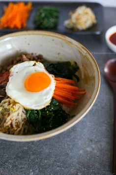 Bibimbap (Korean mixed rice with meat and assorted vegetables) - made this w/o meat. It was very good! The sauce could use less sugar and more spice. I also would make twice as much sauce. There were about two servings without meat.