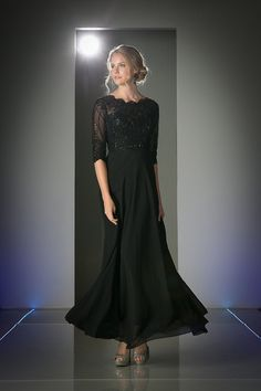 An elegant modest long mother of the bride/groom dress. Features scalloped neckline with sparkling beaded detail the sheer bodice. Classy flowy floor length ski