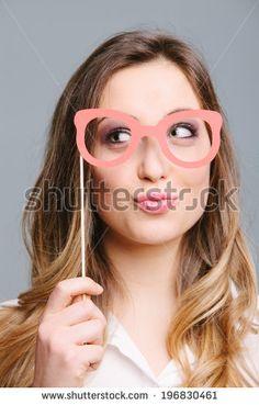 stock-photo-portrait-of-young-woman-wearing-funny-eyeglass-mask-196830461.jpg (300×470)