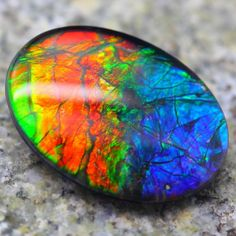 Ammolite. To me, this is one the most spectacular gems out there. It's a relatively new stone from Canada, formed when certain creatures like ammonites fossilized.