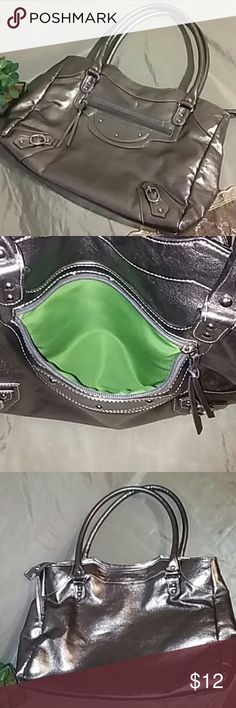 Joan Rivers Classic Silver shiny oversized bag is lined with bright green. Pre-loved but in excellent condition. Very soft and pliable as opposed to hard/stiff. 14x11x3.5 Joan Rivers Classic Bags Shoulder Bags