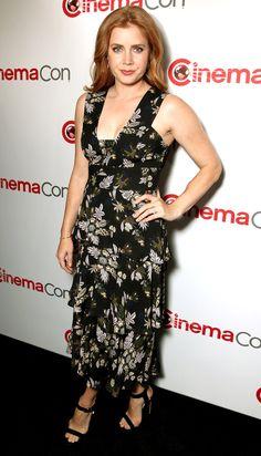 Amy Adams in a floral black midi dress